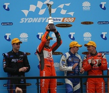 Jamie Whincup (second from left), the most successful driver in the category's history, celebrates winning the 2011 series.