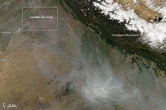 During the autumn and winter months, some 500 million tons of crop residue are burnt, and winds blow from India's north and northwest towards east.[41][42][43] This aerial view shows India's annual crop burning, resulting in smoke and air pollution over Delhi and adjoining areas.