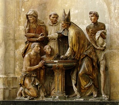 Baptism of Augustine of Hippo as represented in a sculptural group in Troyes Cathedral (1549), France