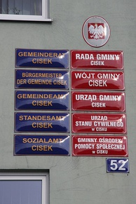 Example of bilingual labeling in German and Polish on the town hall of the Polish village Cisek