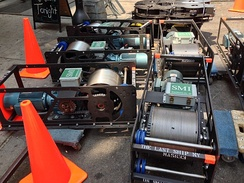 Drum hoists and head blocks ready to be installed at a theater.