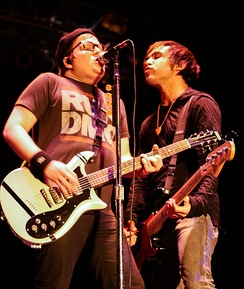 Many of the band's melodies are created by Stump (left), while lyricism is handled by Wentz (right).