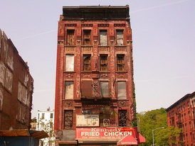 A condemned building in Harlem after the 1970s