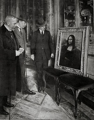 The Mona Lisa in the Uffizi Gallery, in Florence, 1913. Museum director Giovanni Poggi (right) inspects the painting.