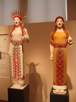 Alternative reconstructions of the Peplos Kore in the Gods in Colour exhibition, at left as Artemis.
