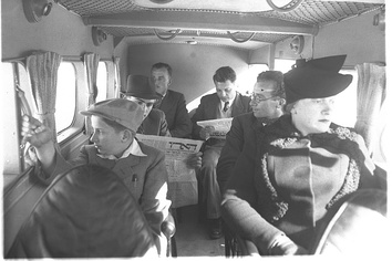Passengers on board a Palestine Airways Short Scion, 1939. The second passenger on the left is reading Haaretz.