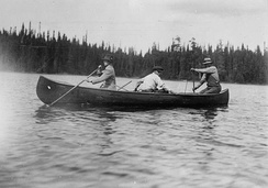 Edward, Prince of Wales with two Ojibwe guides, canoe on the Nipigon River during his 1919 royal tour.