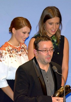 Lead actresses Léa Seydoux and Adèle Exarchopoulos and producer Vincent Maraval accepting the award for Best Film at the 19th Lumières Awards.