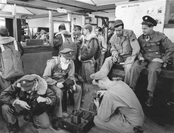 Enlisted men selecting cameras to go up in a Beechraft AT-11 on bomb-spotting missions at Roswell Army Flying School