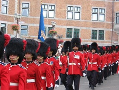 The Royal 22nd Regiment parading in full dress for the 400th anniversary of Quebec City. The Canadian Army's universal full dress includes a scarlet tunic, and midnight blue trousers.