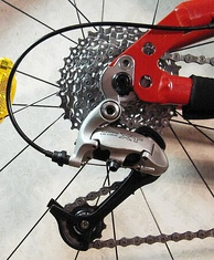 A set of rear sprockets (also known as a cassette) and a derailleur