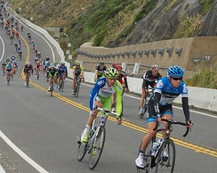 Cyclists descend SR 1 at Devil's Slide on Stage 2 of the 2012 Tour of California before the segment was bypassed one year later by the Tom Lantos Tunnels