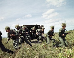 U.S. Army soldiers dismount from an M113 armored personnel carrier during a training exercise in September 1985