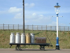 Milk churns on a railway platform