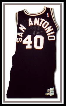 The Spurs sported radially-arched black and white letters on their uniforms during much of the 1980s.[69]