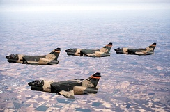 Four Ohio Air National Guard LTV A-7D Corsair II fighters from the 162d Tactical Fighter Squadron, 178th Tactical Fighter Group in flight during 1984. Aircraft identified as AF Ser. No. 69-6222, 69-6233, 70-1053, 71-1298.