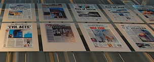 A panel in the Newseum in Washington, D.C., showing newspaper headlines from the day after 9/11.