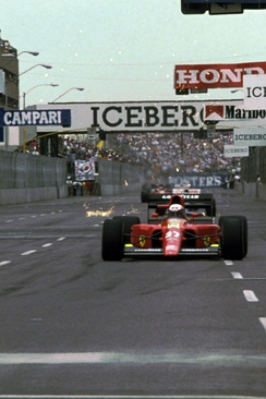 Alain Prost in his Ferrari 642 on the opening lap.