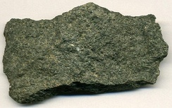 Metamorphosed basalt from an Archean greenstone belt in Michigan, US. The minerals that gave the original basalt its black colour have been metamorphosed into green minerals.