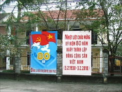 "The Communist Party's propaganda poster commemorating the 80th founding and equating the party with ""peace, prosperity and happiness"""
