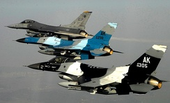 Three U.S. Air Force F-16 Block 30 aircraft fly in formation over South Korea, 2008