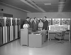 IBM 7090 mainframe computer at Ames in 1961. Smith DeFrance, Ames' founding director, is second from the left.