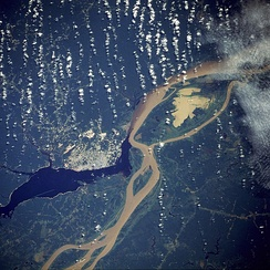 Manaus, the largest city in Amazonas, as seen from a NASA satellite image, surrounded by the dark Rio Negro and the muddy Amazon River