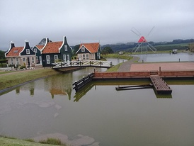 View of the Carambeí Historical Park mill and houses in Dutch architecture on the left
