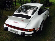 Rear-engined 911: engine's center of mass is concentrated within the overhang, outside the wheelbase.