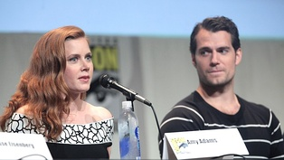 Adams and Henry Cavill, her co-star in the DC Extended Universe, at the 2016 San Diego Comic-Con