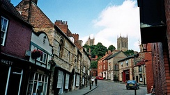 A view up 'Steep Hill' towards the historic quarter of Bailgate in Lincoln