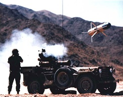 A TOW missile being fired from an M151.