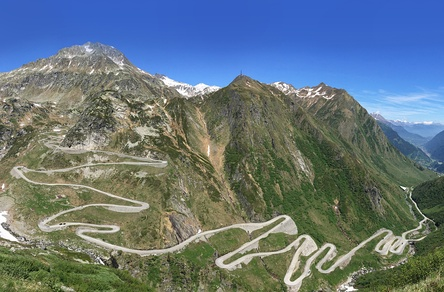 Photo shows the road that zig-zags up the Val Tremola toward the Gotthard Pass.