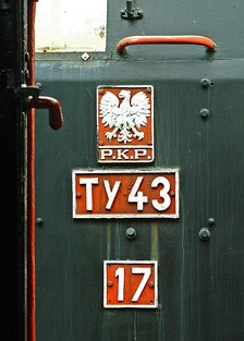 An example of a Ty43 class locomotive designation: T stands for freight locomotive and y stands for 2-10-0 wheel set. 43 describes Polish production, 1943 year of design approval.