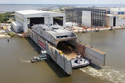 The USNS Spearhead (JHSV-1), another Austal USA-built ship, being prepared for its christening in the BAE Systems Southeast Shipyards floating drydock in September 2011. The Spearhead is the first ship of the Spearhead class Joint High Speed Vessel (JHSV).