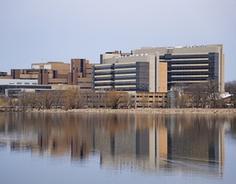 A view of UW Health University Hospital, the Health Sciences Learning Center (HSLC), and the Wisconsin Institutes for Medical Research rising above Lake Mendota, on the western edge of the UW–Madison campus. The University of Wisconsin School of Medicine and Public Health, housed in the HSLC, accounts for 40% of UW–Madison's research grants[57]