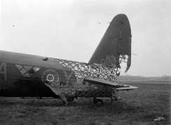 Geodesic airframe fuselage structure is exposed by battle damage