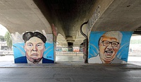 A mural with Kim Jong Un and Donald Trump in Vienna.