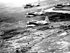 A-1E Skyraiders fly in formation over South Vietnam on way to target on 25 June 1965. The aircraft are assigned to the 34th Tactical Group, based at Bien Hoa Air Base, South Vietnam.