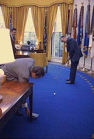 Bob Hope, a golf fan, putting a golf ball into an ashtray held by President Richard Nixon in the Oval Office in 1973