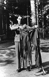 A soldier holding the trousers Hitler wore during the failed assassination attempt.[38]
