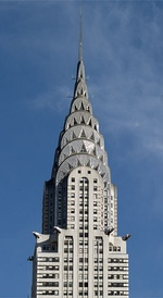 The Chrysler Building, above, built in 1930, is an example of the Art Deco style, with ornamental hub caps and a spire. The Empire State Building is a solitary icon of New York. It was the world's tallest building 1931–70 and is defined by its setbacks, Art Deco details and the spire.