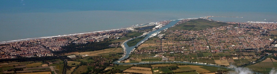 The river mouth of the Tiber and city of Fiumicino on the Tyrrhenian Sea