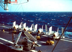 4 FJ-3 Fury fighter-bombers of VF-33 and an AD-6 of VA-25 on the deck of USS Intrepid in the North Atlantic in 1957