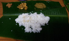 Food served on a banana leaf, a traditional way of serving food more popular in southern India