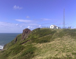The coastguard station higher on the top of the point