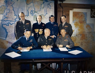 Meeting of the Supreme Headquarters Allied Expeditionary Force (SHAEF), 1 February 1944. Front row: Air Chief Marshal Arthur Tedder; General Dwight D. Eisenhower; General Bernard Montgomery. Back row: Lieutenant General Omar Bradley; Admiral Bertram Ramsay; Air Chief Marshal Trafford Leigh-Mallory; Lieutenant General Walter Bedell Smith.