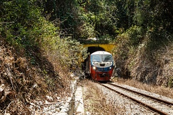Sabah State Railway train passing through a tunnel of the Western Line in Pengalat Besar, Papar District.