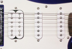 "Pickups on a Fender Squier ""Fat Strat"" guitar—a ""humbucker"" pickup on the left and two single-coil pickups on the right."