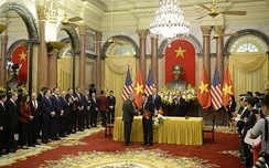 U.S. Secretary of State Rex Tillerson accompanies U.S. President Donald Trump to a commercial deals signing ceremony with Vietnamese President Tran Dai Quang at the Presidential Palace in Hanoi, on November 12, 2017